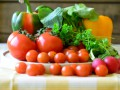 Tomatoes, radishes, peppers, parsley and chopping board